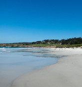 As you're walking down Carmel Beach, get a glimpse of the world famous Pebble Beach Golf Course. Where many have their try at winning a golf game on these challenging greens.